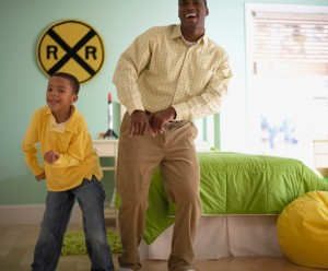 Father and Son Dancing Together --- Image by © Royalty-Free/Corbis